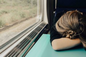 Woman head down on a train