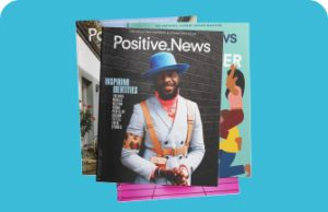 A selection of magazine covers, the one on the top has a photo of a man with a blue hat and white coat. The headline is Positive News